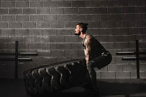 Man Working Out at CrossFit Gym